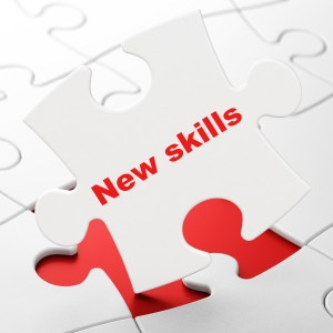 Education concept: New Skills on puzzle background